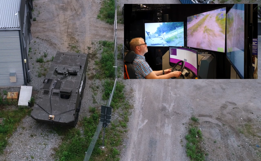 A person remotely operating an armoured vehicle at Tampere University
